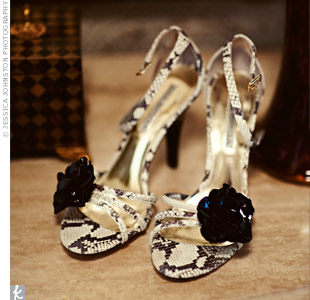 To spice up her look (and match her bridesmaids), Joanna wore black-and-white snakeskin leather heels with patent-leather roses.