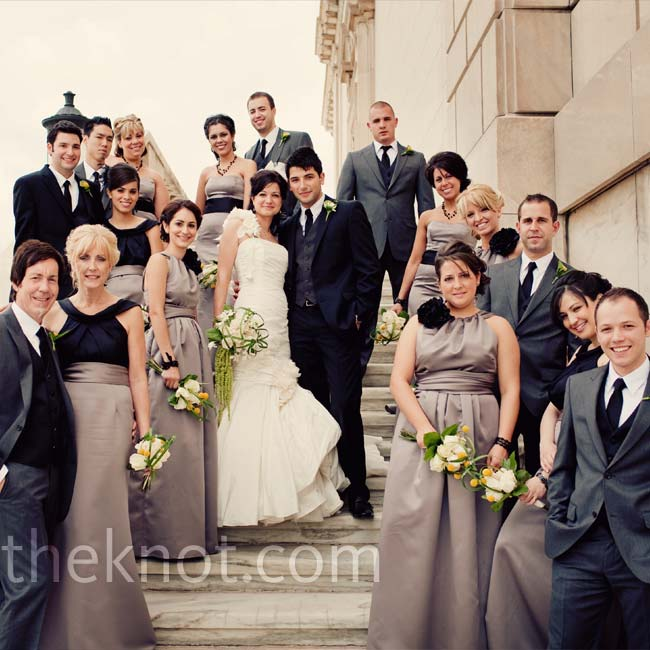 Joanna's nine bridesmaids wore three different-style gray dresses by the same designer. All the dresses had some kind of black accent -- a bloom at the neckline or a sash around the waist. Besides Hebert and his best man (who wore black), all the groomsmen wore gray suits.