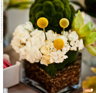 To add more depth to the room, the couple chose four different types of centerpieces to alternate on the tables, each with a minimalist vibe. Their own table had a low, square vase filled with white hydrangeas, green dendrobium orchids, yellow craspedia, and green moss balls and stones.