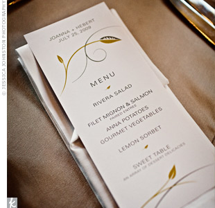 Like all the wedding stationery, the menu cards featured the couple's signature design of a city skyline within a leaf. Joanna and Hebert went with a thin, all-caps font for a sleek, modern look.