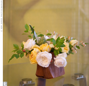 Short, wooden containers displayed organically arranged roses on some of the tables.