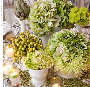 Aimee collected over one hundred pieces of vintage milk glass for her centerpieces. Each table was decked out with small arrangements of green hydrangea, spider mums, Irish bells, gladiola, green roses, button mums, as well as vegetables like artichokes and asparagus.