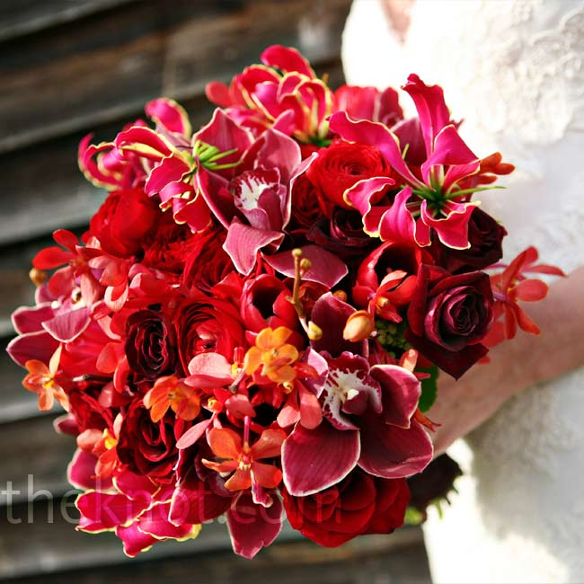 Alison carried a mostly monochromatic bouquet but the loose arrangement of red roses, orchids, and gloriosa lilies made it visually interesting. Her maid of honor's bouquet was a smaller version of her own.