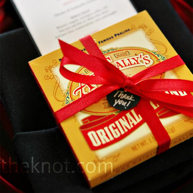 Guests took home individually wrapped boxes of Alison's favorite pralines from Aunt Sally's in New Orleans. The bride personalized them with red ribbon and black handwritten tags.