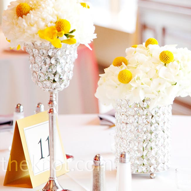 The bride and groom decided to have three different types of centerpieces at the reception. Some tables were decorated with a cluster of jeweled vases of different heights.