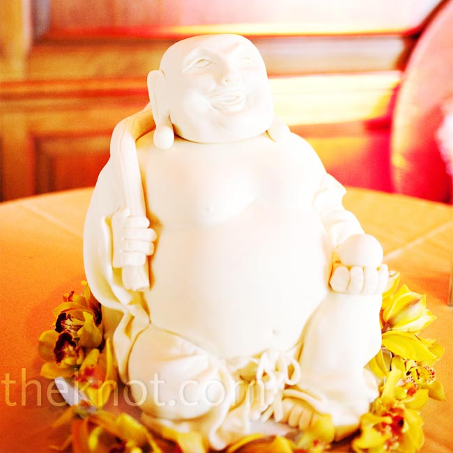 """I collect Buddhas and try to buy one in every city I visit,"" says Ana. She was surprised when she met Mike to find out that his nickname is Buddha! It was only fitting that Mike's groom's cake was a carrot cake, cream cheese-filled, fondant-covered Buddha."