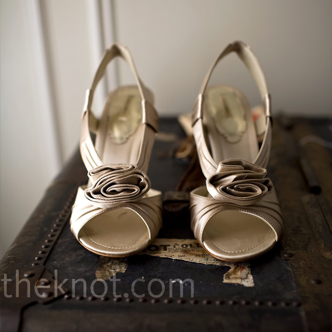 The bride wore her satin slings backs for both the ceremony and the reception. The folded rosette detail on the open toe mimicked the floral detailing on Jennifer's gown.
