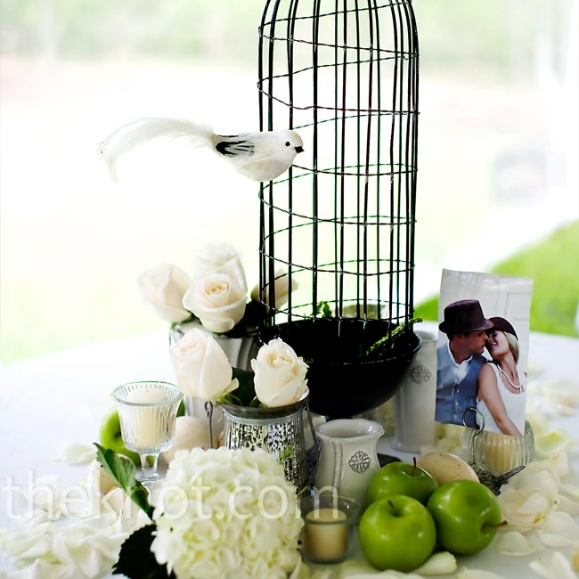Each centerpiece for the reception tables was unique; the arrangements were created from objects that Jennifer collected from flea markets and even some she pulled from her own house.