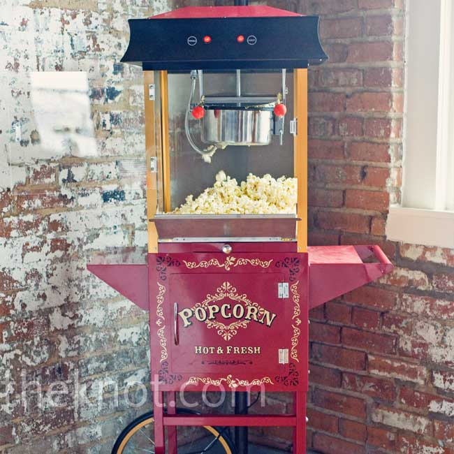 Retro touches, like a carnival popcorn machine, added to the ambiance and provided guests with a fun snack.