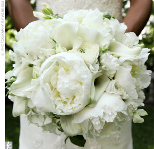 Melissa left the design of her bouquet entirely up to her florist. She was thrilled with the results: a gorgeous bouquet of romantic peonies, ranunculus, hydrangeas, calla lilies, tulips, and sweet pea.