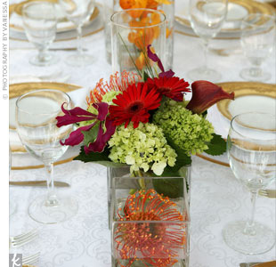 Because the reception table was narrow and long, Melissa really wanted arrangements that were low so that guests could easily see across. An assortment of vases were scattered down the center of the banquet table.