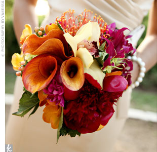 Very different from Melissa's bouquet, the bridesmaids carried a colorful arrangement of mini calla lilies, peonies, and tulips. Because they chose such minimal decorations for the ceremony space, the bridesmaids bouquets really popped.