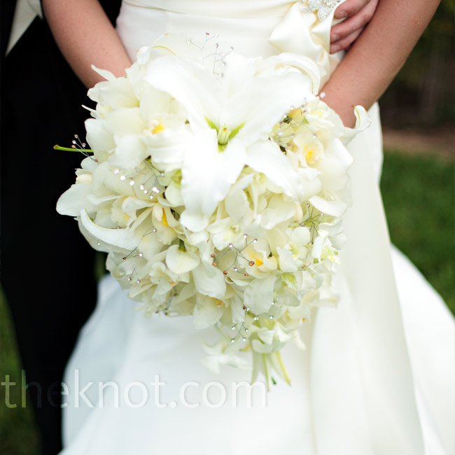 Ryan's florist upped the glamour of her cascading bouquet of white Oriental lilies by adorning it with rhinestones and satin ribbon.
