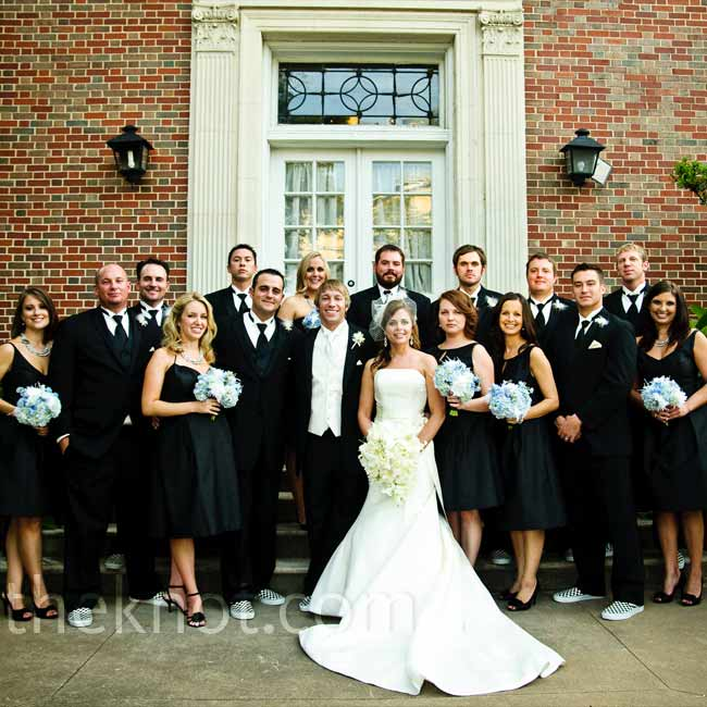 """Ryan's six bridesmaids each wore a black silk shantung cocktail dress with a full skirt and side pockets but they were able to choose from four different styles. """"I wanted each bridesmaid to have a dress that fit her body type best and was something that they felt comfortable in."""""""