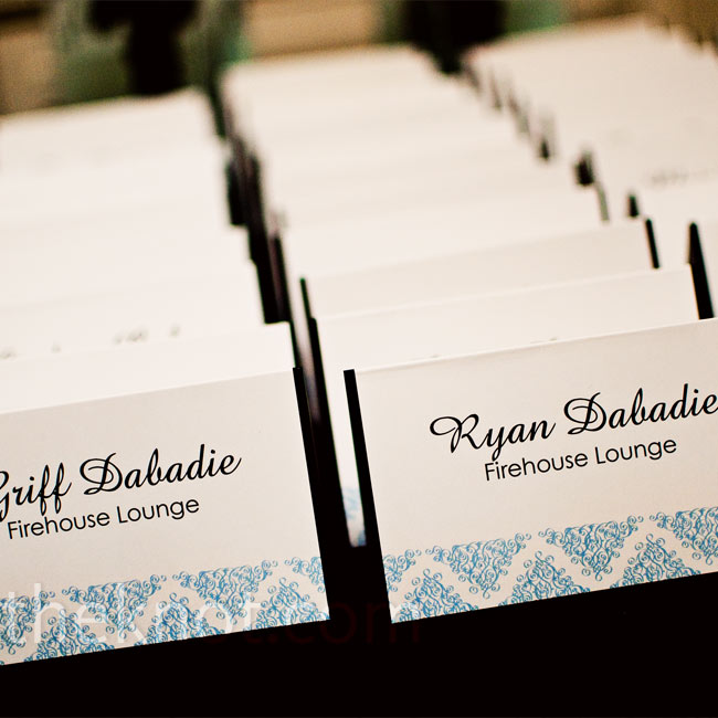 "Even the smallest detail is a place to ""stamp"" your wedding with personality, as Ryan did on her escort cards by including the signature icy blue color."