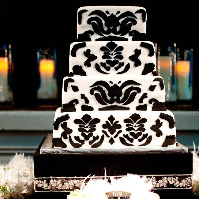The four tiers of the bride's cake were decorated in black and white fondant meant to look like damask.