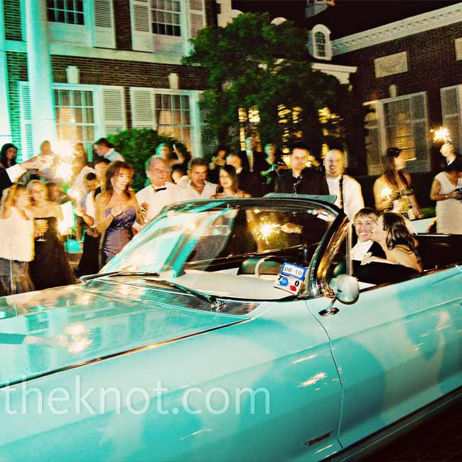 """Guests sent Ryan and Griff off in a 1961 Cadillac convertible. """"We're both vintage car nuts,"""" says Ryan."""