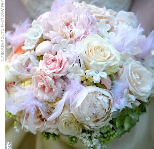 To give her bouquet a romantic feel, Shelly had her florist tuck white feathers in between bursts of hydrangea, roses, peonies, ranunculus, and stephanotis.