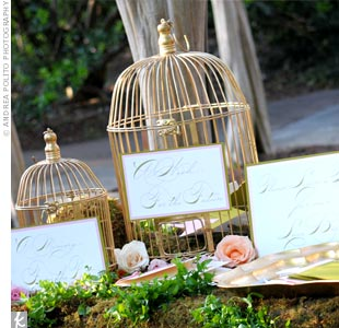 Guests wrote notes and well wishes to the bride and groom on bird-shaped pieces of paper and tucked them inside cages.