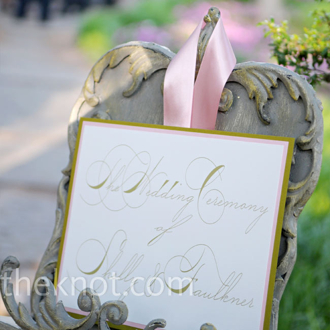 """My overall wedding theme was sort of A Midsummer Night's Dream -- I wanted everything to be something found in the garden,"" Shelly states. She incorporated birds, feathers, nests, and moss into all of the decorations and chose a palette the color of a sunset (lots of apricot, coral, blush pink, and gold)."