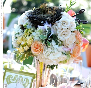 The bird-and-nest theme carried through to the centerpieces as well. Shelly had her florist incorporate a small bird's nest into the two different centerpiece designs that adorned the reception tables.