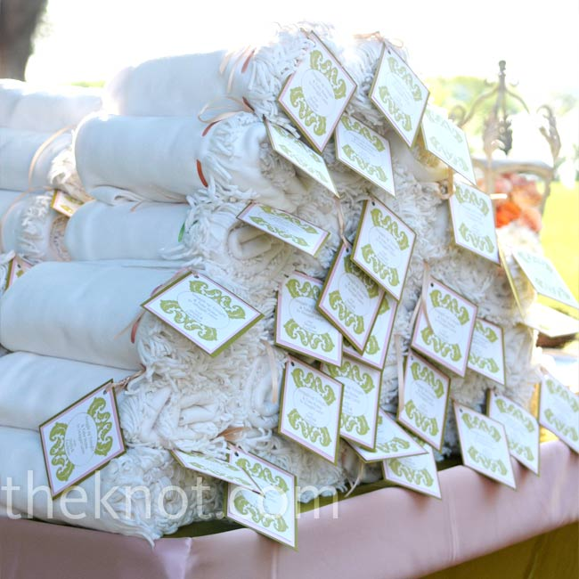 The bride and groom wanted to give favors that would get a lot of use, so they chose soft throw blankets and personalized them with a tag that Shelly and her mother designed.