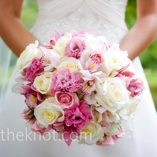 "Kelly worked closely with her florist to create the wedding flowers, which were inspired by images the bride found that ""reminded me of an English garden."" The bride's lush, textured bouquet included white hydrangeas and roses, blush pink roses, and mauve cymbidium orchids."
