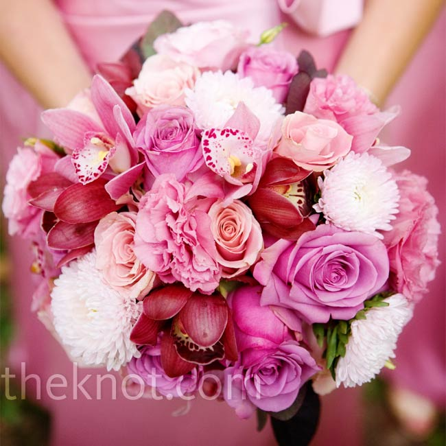 Kelly's bridesmaids' carried hand-tied bouquets that incorporated all shades of pink, from burgundy cymbidium orchids to mauve lisianthus to pale pink roses.