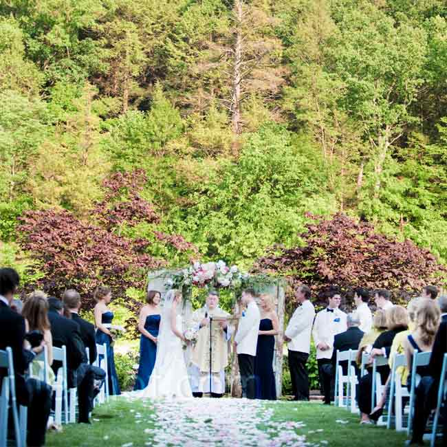 Lindsay and Michael got married on the resort's spa lawn. They created a backdrop for the ceremony using two antique doors, which were decorated with pink flowers and pale pink fabric.