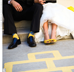 Yellow sling-back heels with adorable bows were the perfect way to add a pop of color to Andreas look -- and Robert wore socks to match!