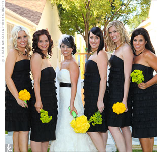 Andrea found great (and affordable) ruffle dresses for her bridesmaids at the Gap! She chose black to match the sash on her gown.