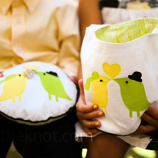 An Etsy seller custom-made a ring pillow and flower girl bag with birds that matched the ones on Andrea and Robert's invitations.