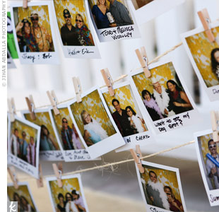 The couple hung the escort cards from twine with mini clothespins; after guests took their cards, they were asked to replace them with a Polaroid of themselves from the DIY photo booth. That way, when new guests arrived, they knew who was already there.