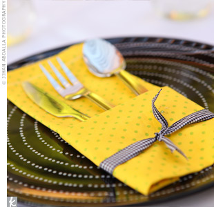 Andrea enlisted her mom's help in sewing colorful napkins out of various patterned fabrics. They tied black and white ribbon around them and placed them on polka-dot plates.