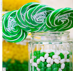 Andrea and Robert bought their favorite yellow, green, and white sweets and set up a candy buffet to look like something out of an old-fashioned candy store.