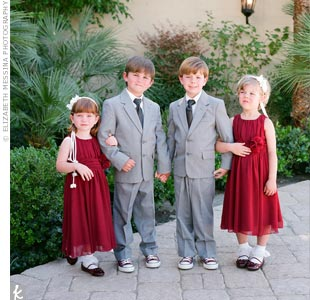 Matching the color palette, the two flower girls wore red patent Mary Janes and dark-red dresses; the ring bearers wore red Converse sneakers with their gray suits.