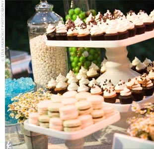 In addition to a wedding cake, Courtney and Andrew offered a dessert bar with macaroons, mini cupcakes, blue and white candy, and other sweets.