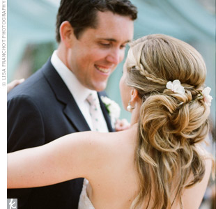 Andrew loves when Courtney's hair is swept back in a side part, so for their wedding day she wore it just that way -- curled, half up, half down with a braid on the side. For a personal touch, she added flowers picked from her father and stepmother's garden.