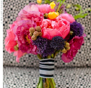 Hot pink added color to the black-and-white theme. The girls' bouquets included peonies, dahlias, and roses, and the striped ribbon tied around it brought the whole look together.