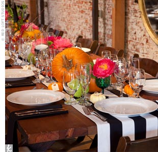The long dining tables were adorned with homemade black-and-white table runners. Marvimon's brick walls are definitely untraditional and fit the wedding's look.