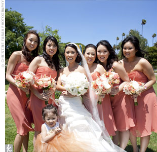 Keeping with the color palette, Min's bridesmaids wore short terracotta-colored chiffon dresses. Her flower girl wore a whimsical tutu-style dress in coral, peach, and copper.