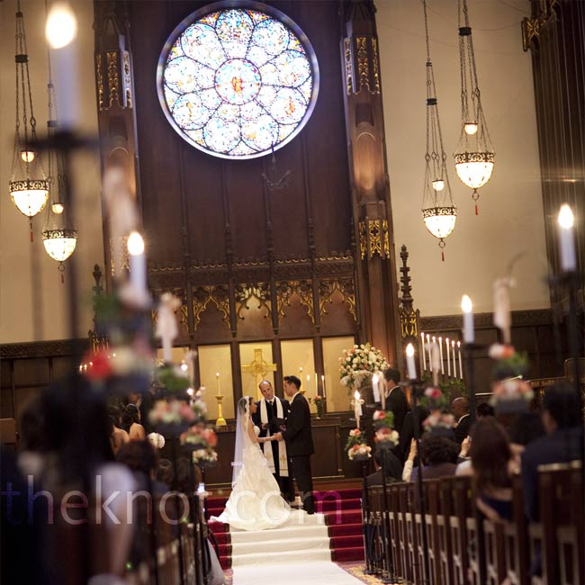 Min and Jason knew they needed plenty of room for the hundreds of guests they planned to invite. They chose a church that seats up to 500 people and some guests still had to stand! A few flowers and candles decorated the 106-foot long center aisle.
