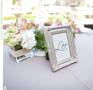 To add a touch of vintage to the reception tables, Min and Jason used vintage-style silver frames for the table names.