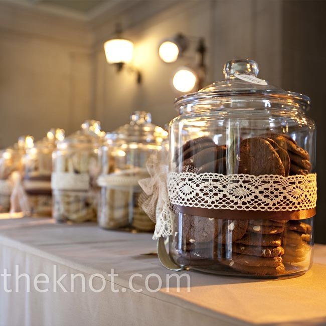 Min and Jason displayed dozens of cookies in vintage glass jars for guests to help themselves. Carefully placed spotlights made the treats look even more tempting!