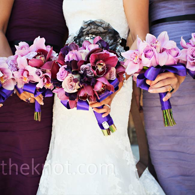 Theresa wanted lots of color and requested no shades of white or gold in the bouquet. She and her girls carried purple bouquets of roses, orchids, and tulips.
