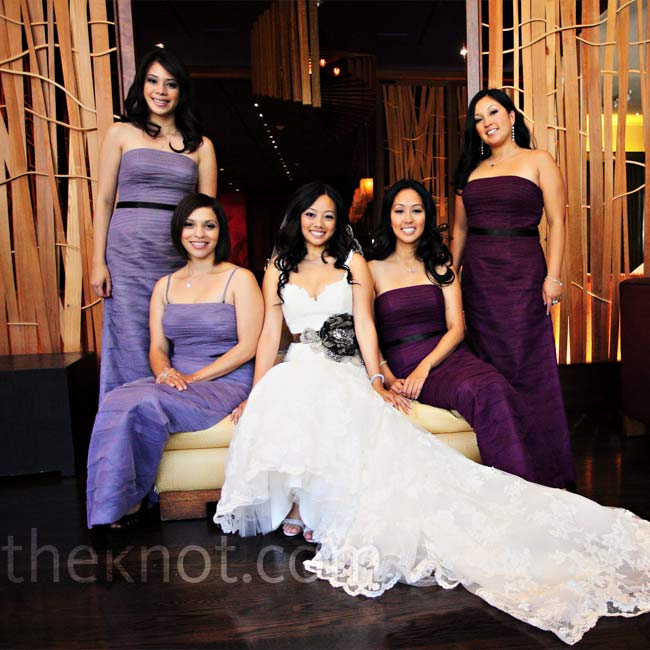 The girls wore floor-length, A-line, ruched dresses with black satin ribbons around their waists. In keeping with the idea of having many shades of purple, Theresa's two maids of honors wore eggplant and her two bridesmaids wore lilac.
