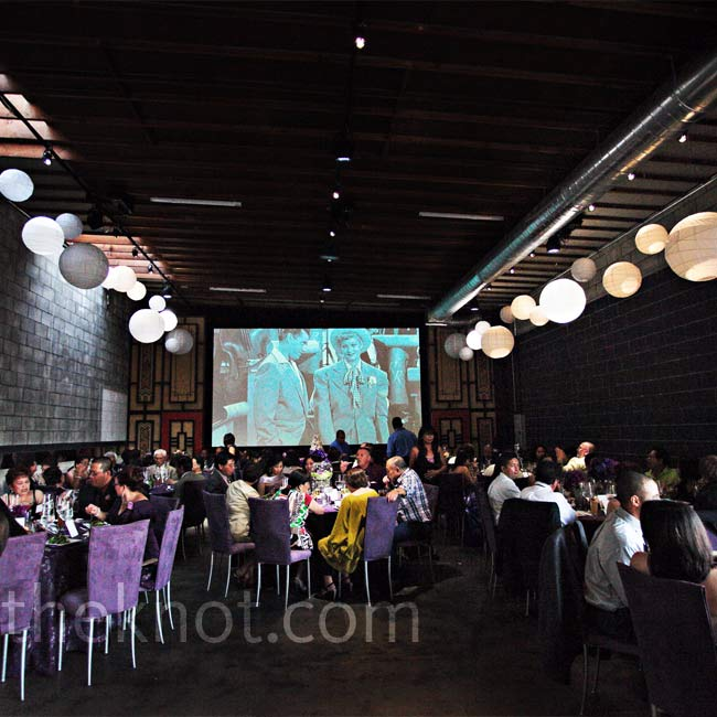 Theresa and Ken wanted an urban reception space, and SmogShoppe, with its brick walls, provided just that. To lighten up the dark linens and lilac suede chairs, airy paper lanterns hung from the ceiling. And for a personal touch (and a few laughs), Theresa's favorite episodes of I Love Lucy were projected on one wall during dinner.