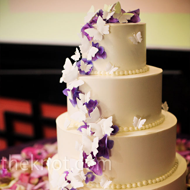 For a feminine look, Theresa and Ken incorporated butterflies into their wedding motif. Purple and white ones, handmade of sugar, cascaded down their smooth, buttercream cake.