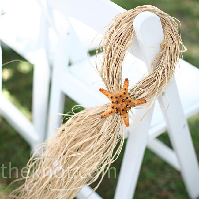 For a touch of beach-style decor, Deanne and Will hung streaming raffia, affixed with starfish, to the aisle chairs.