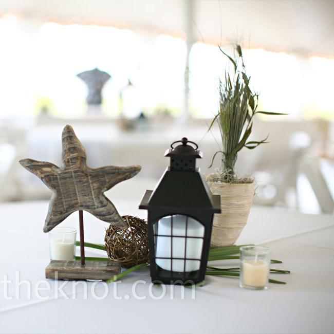 Clusters of shell vases filled with sea grass, lanterns, wooden starfish, and various succulents kept the reception décor consistent with the natural surroundings.